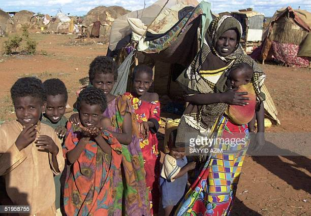Somali mother and her children are seen 20 May 2002 in the Kenyan border town of Mandera Some 10000 Somalis have fled their homes in Bulo Hawo a...