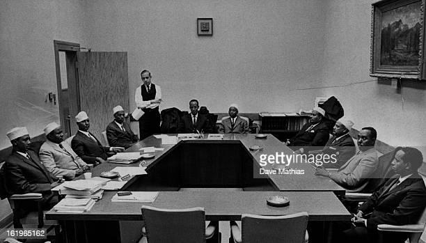 MAR 7 1967 Somali * People Somali Legislators Visit Denver Ralph Bryant standing staff director of the Colorado Legislature's Joint Budget Committee...
