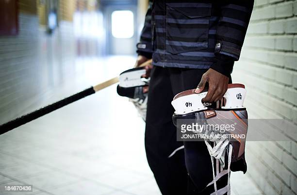 Somali player holds his skates on his way to the Somali national Bandy team's training session on September 24 2013 in the city of Borlaenge Sweden...