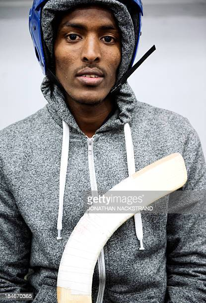 Somali player poses ahead of the Somali national Bandy team's training session on September 24 2013 in the city of Borlaenge Sweden Somali refugees...