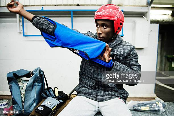 Somali player prepares ahead of the Somali national Bandy team's training session on September 24 2013 in the city of Borlaenge Sweden Somali...