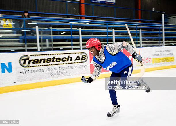 Somali player reacts after scoring during the Somali national Bandy team's training session on September 24 2013 in the city of Borlaenge Sweden...