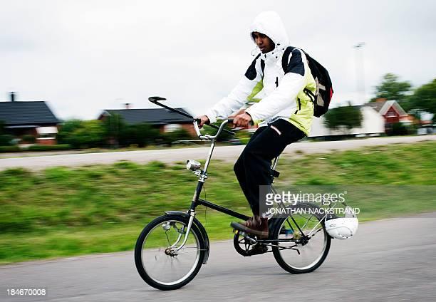 Somali player rides his bike after the Somali national Bandy team's training session on September 24 2013 in the city of Borlaenge Sweden Somali...