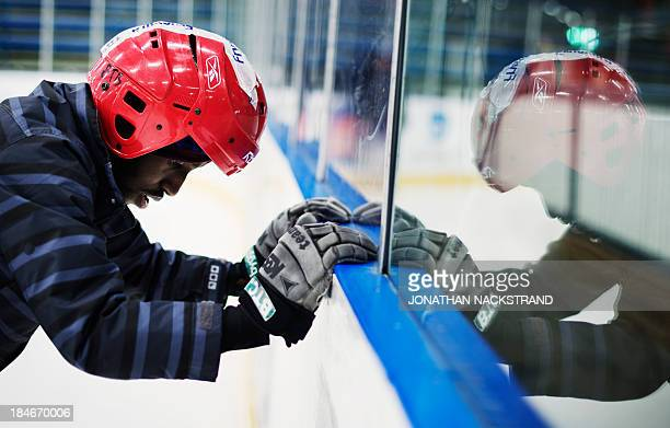 Somali player works on his ice balance as he takes part in the Somali national Bandy team's training session on September 24 2013 in the city of...
