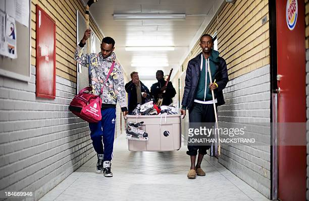 Somali players carry their national Bandy team's equipment after their training session on September 24 2013 in the city of Borlaenge Sweden Somali...
