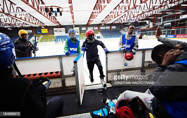 Somali players leave the ice after the Somali national Bandy team's training session on September 24 2013 in the city of Borlaenge Sweden Somali...