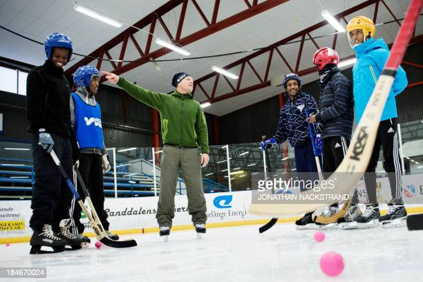 Somali players listen to their coach Swedish Per Fosshaug during the Somali national Bandy team's training session on September 24 2013 in the city...