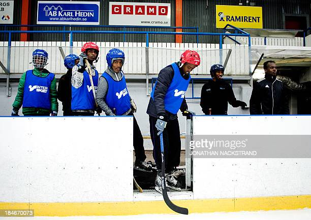 Somali players prepare to step down to the ice during the Somali national Bandy team's training session on September 24 2013 in the city of Borlaenge...