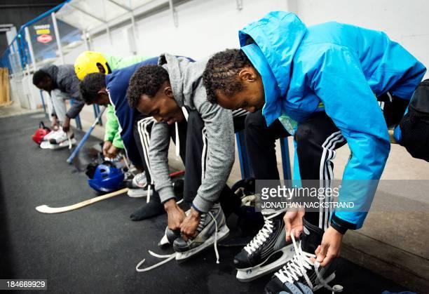 Somali players prepare to take part in the Somali national Bandy team's training session on September 24 2013 in the city of Borlaenge Sweden Somali...