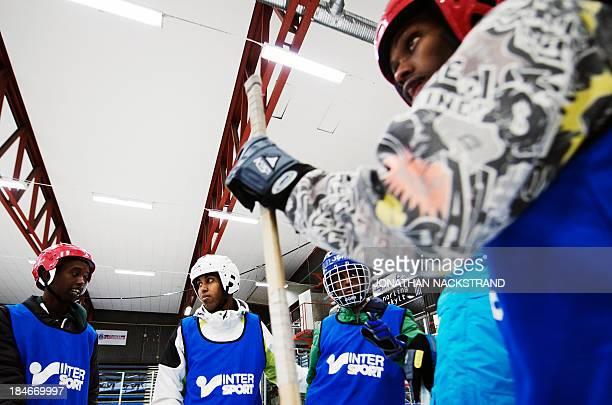 Somali players take part in the Somali national Bandy team's training session on September 24 2013 in the city of Borlaenge Sweden Somali refugees in...