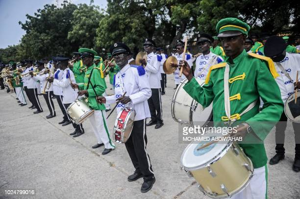 TOPSHOT Somali police force attends a handover ceremony as African Union Mission to Somalia leaves from the Mogadishu stadium in Mogadishu Somalia on...