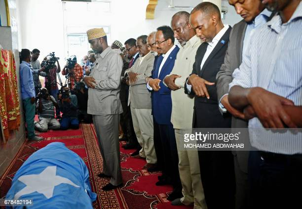 Somali President Mohamed Abdullahi Farmajo Somali Prime Minister Hassan Ali Khaire and other officials pray over the body of assassinated Public...