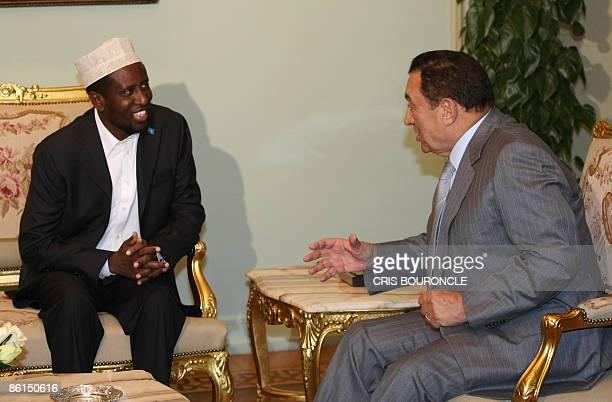 Somali President Sheikh Sharif Sheikh Ahmed meets with Egyptian President Hosni Mubarak in Cairo on April 22 2009 AFP PHOTO/CRIS BOURONCLE