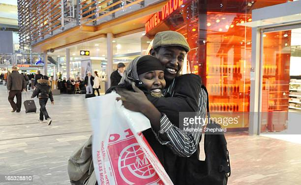 ISMAIL 0104/11 OSLO NORWAY Somali refugee Ismail Khalif Abdulle hugs his cousin Quman Abdulahi at the airport before boarding a flight to Harstad a...