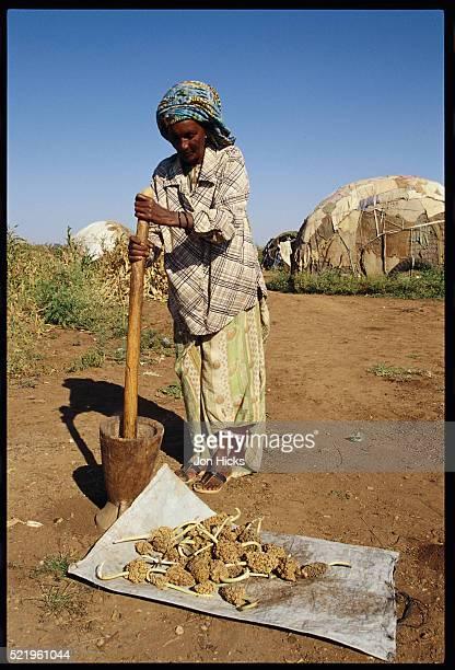 Somali Refugee Using Mortar and Pestle