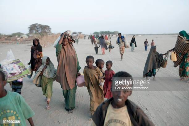 Somali refugees arrive early in the morning outside the Dagaley refugee camp on July 31 2011 in Dadaab Kenya Hundreds of thousands of people have...