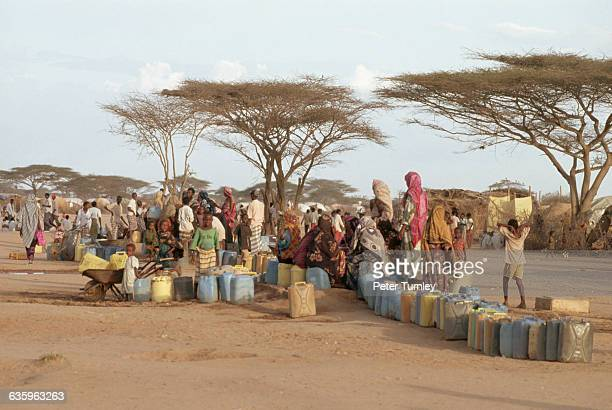Somali refugees at the Dasahley refugee camp share a watering hole with local Kenyan nomads | Location Dasahahley refugee camp Kenya