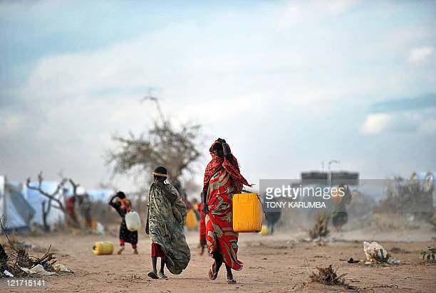 Somali refugees fetch water at the new Ifoextension in Dadaab on July 31 2011 The new site opened to some 5000 refugees among an ever swelling number...