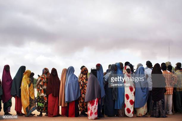 Somali refugees seek information about a move to a different displacement camp due to overcrowding August 24, 2008 at Dadaab, the world's biggest...