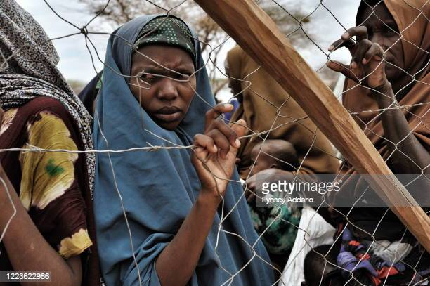 Somali refugees seek shelter in Dadaab camp after fleeing a prolonged drought in Somalia, near the Kenyan border with Somalia, August 20, 2011....