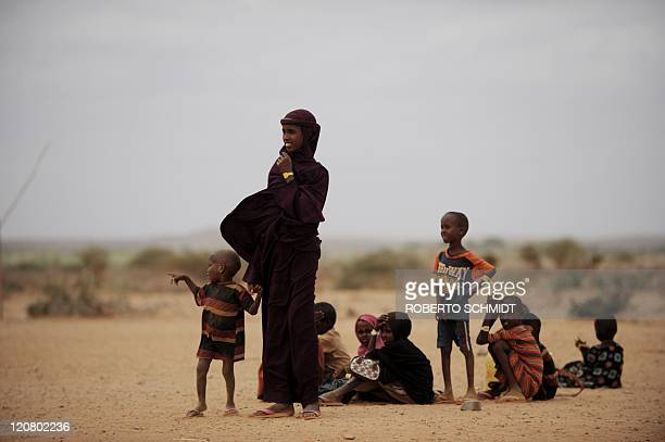 Somali refugees stand near a food distribution point at the Kobe refugee camp near the EthiopiaSomalia border on July 19 2011 Ethiopian authorities...