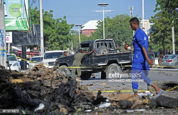 Somali security forces gather at the site of a bomb blast near Makka alMukarama Road in the Somali capital Mogadishu on December 19 2015 Several...