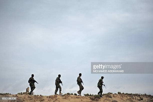 TOPSHOT Somali security forces patrol along the coast of Qaw in Puntland northeastern Somalia on December 2016 Armed militants groups have become...