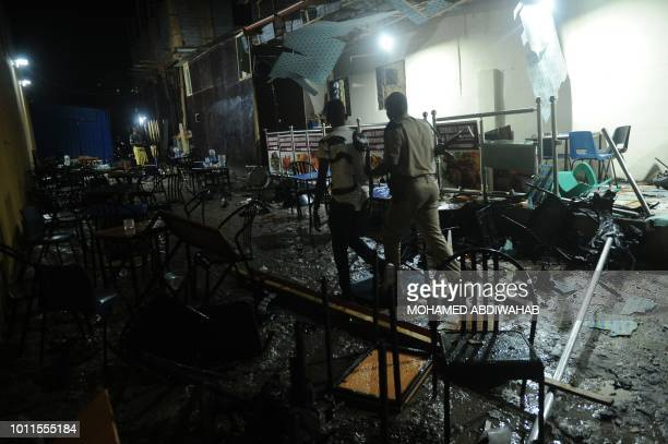 Somali security forces secure the site of a car bomb explosion in Mogadishu on August5 2018 At least three were killed and five others injured after...