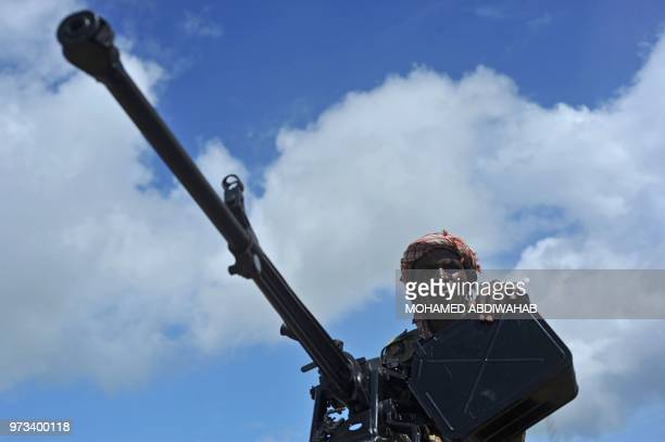 Somali soldier holds a machine gun at Sanguuni military base, where an American special operations soldier was killed by a mortar attack on June 8,...