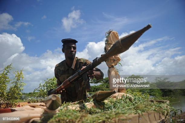 A Somali soldier holds a mortar gun at Sanguuni military base where an American special operations soldier was killed by a mortar attack on June 8...