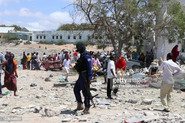 A Somali soldier is seen at the car bomb scene on September 2 2018 in Mogadishu A suicide car bomb killed three security guards and injured several...