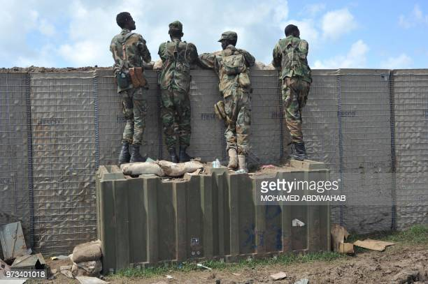 Somali soldiers are on patrol at Sanguuni military base, where an American special operations soldier was killed by a mortar attack on June 8, about...