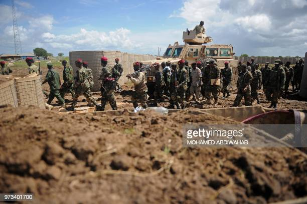 Somali soldiers enter Sanguuni military base where an American special operations soldier was killed by a mortar attack on June 8 about 450 km south...
