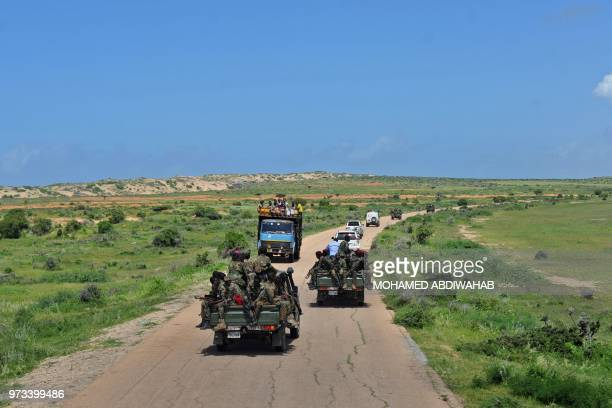 Somali soldiers patrol in convoy near Sanguuni military base, where an American special operations soldier was killed by a mortar attack on June 8,...
