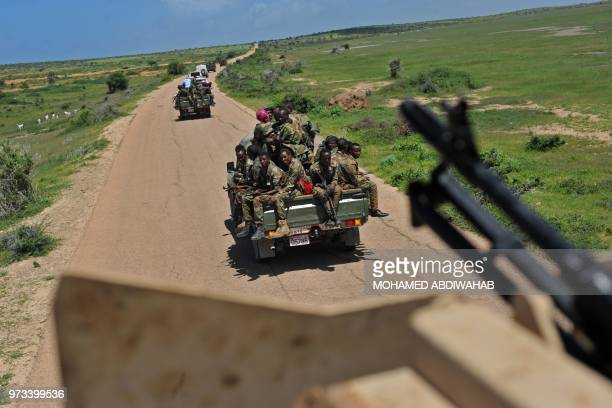 Somali soldiers patrol in convoy near Sanguuni military base where an American special operations soldier was killed by a mortar attack on June 8...