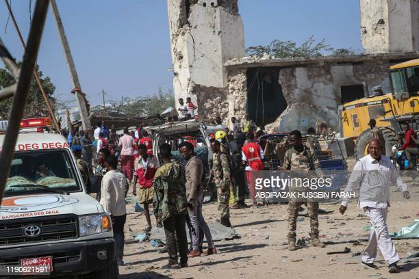 Somali soldiers secure the scene at a car bombing attack site in Mogadishu, on December 28, 2019. - A massive car bomb exploded in a busy area of...