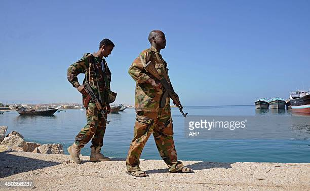 Somali soldiers walk along Bosaso harbor in Puntland on November 18 2013 After increased security in Somalia's Puntland region Bosaso has become a...