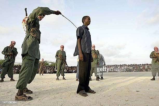 A Somali teenaged boy reacts to a lash after being convicted of raping a young minor in Mogadishu Somalia on March 9 2009 Four young boys were...
