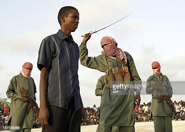 A Somali teenaged boy reacts to a lash after being convicted of raping a young a minor in Mogadishu Somalia on March 9 2009 Four young boys were...
