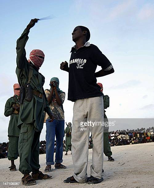 A Somali teenaged boy reacts to a lash after being convicted of raping a young a minor in Mogadishu Somalia March 9 2009 Four young boys were...