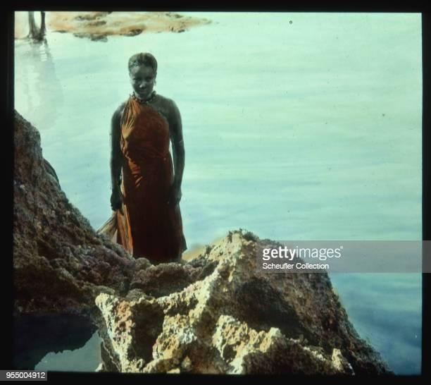 Somali washwoman A washwoman stands on the rocky shore of the Indian Ocean Mogadishu Somaliland 1920s 1920s Italian Somaliland
