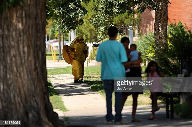 A Somali woman heads to a horse shoe set of apartments on State Street in Fort Morgan Joe Amon The Denver Post