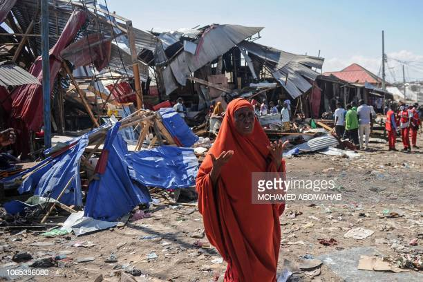 A Somali woman reacts after a car bomb detonated at a busy market in the capital Mogadishu Somalia on November 26 2018 The explosion occurred after...
