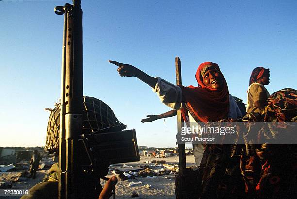 Somali woman screams at a U.N. Peacekeeper after being detained for looting at the Egyptian United Nations troop compound February 24, 1995 in...