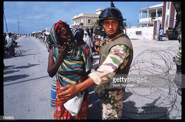 Somali woman speaks to a United Nations soldier June 6 1993 in Mogadishu Somalia UN troops seized the residence of General Mohammad Aidid a warlord...