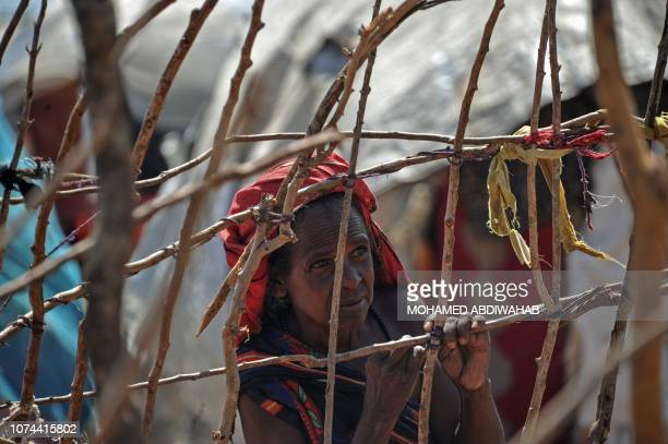 Somali woman stands in an internally displaced people camp as hundreds of people recently fled from southern Somalia US's airstrikes against al...