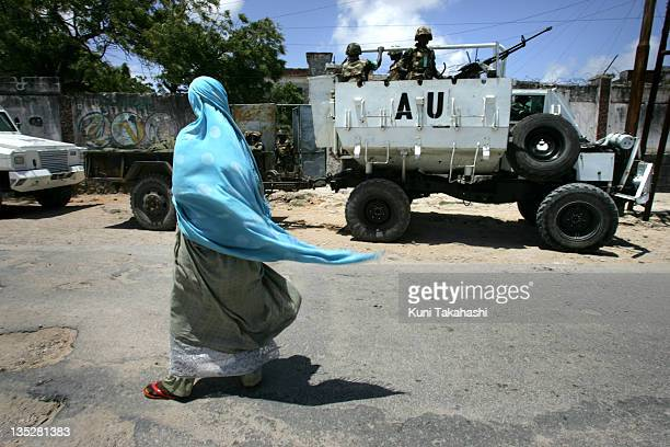 Somali woman walks by African Union Ugandan soldiers October 7 2007 in Mogadishu Somalia 1600 Ugandan soldiers are stationed in the capital of...