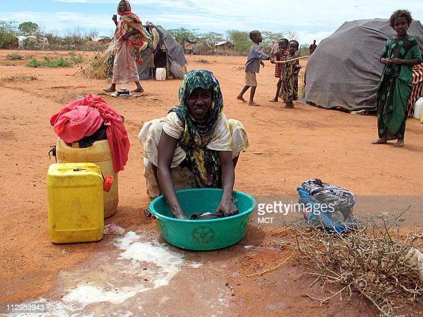 A Somali woman washes laundry in a refugee camp in northeastern Kenya October 21 2006 About 14000 Somalis have fled into Kenya since September...