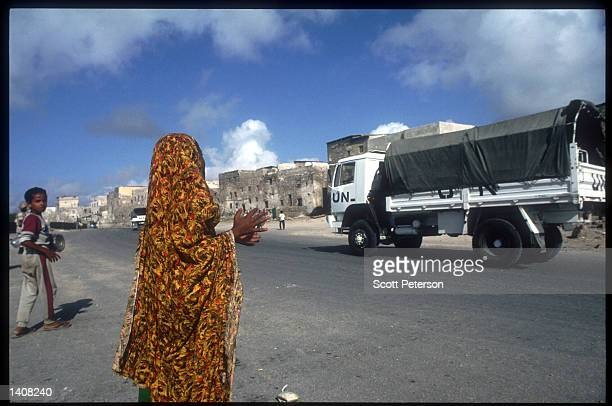 Somali woman watches a UN truck drives down the street October 14 1993 in Somalia The United Nations aim in Somalia was set up to facilitate...