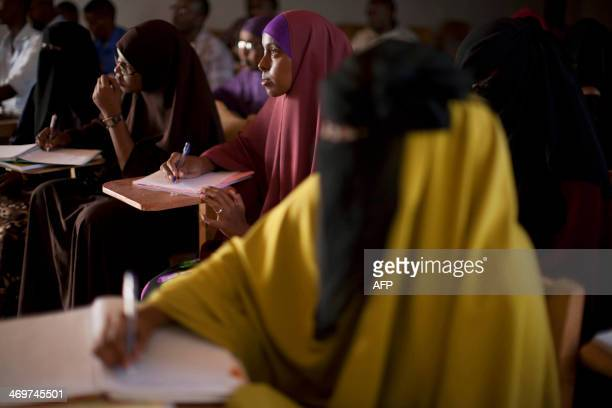 Somali women attend a class at the mixed Hope University in Mogadishu Somalia on February 16 2014 AFP PHOTO / JM LOPEZ
